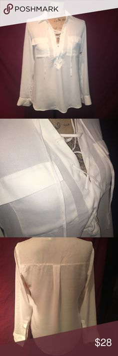 Express chiffon front lace up blouse NWT Express chiffon white blouse. Collared with v neck front and lace up style. 2 front pockets. Full cuffed sleeve that can be rolled up and buttoned. Slightly longer in the back. Includes extra button. Please excuse my poor ironing job. Express Tops Blouses