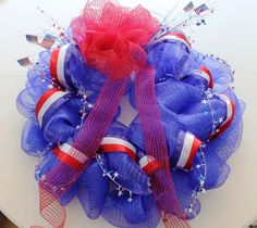 Happy (almost) 4th of July! Having a big summer cookout or just want to add something festive to your front door? I just got done decorating my front porch and wanted to share! A decorative mesh wreath is not that difficult to make — and I've included instructions below for how to make your own. I learned [...]