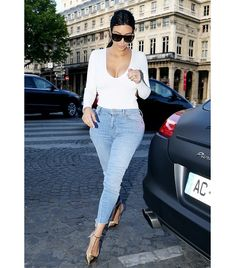 @Alexandra M What Wear - Lesson 1: Keep your denim game tight (raw hems rule). On Kardashian: ​Mother The Looker Ankle Fray Skinny Jeans ($196); Christian Louboutin heels.
