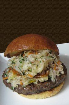 Wild Boar Burger with Citrus Slaw and Barbeque Sauce Serves 4. Citrus Slaw Ingredients: 1/4 head cabbage, shredded 1 red bell pepper, sliced 1 red onion, sliced 1/2 cup pickle juice 1/2 carrot,...