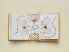 """Illustrator Carol Kearn's butterfly pop-up book. Found here. The book is about 4-3/4″ x 4-3/4″ (12cm x 12cm). """"There are a total of 18 pages. including 3 double-spreads which feature paper engineered 'pop-ups'."""" And she made an edition of 50."""
