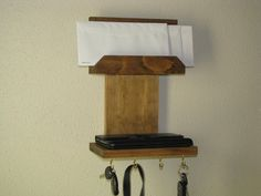 Uniquely designed hanging organizer with a place for your mail it also has a storage shelf and four hooks for your keys, dog leashes or