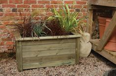 pictures of plants in OUTDOOR planters | Large wooden trough garden planter for decorative planting of plants ...