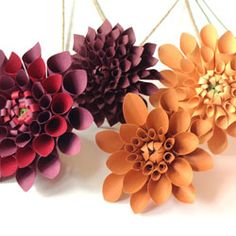 Paper #Dahlias by Paper Portrayals. The National Flower of Mexico sports numerous delicately curled petals encircling a budding core. #paperflowers #paperdahlias