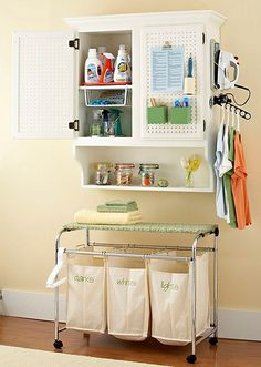 great laundry organization....love the ironing board on top