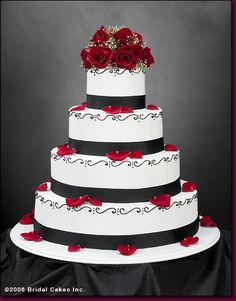 Black and white wedding cakes with red roses