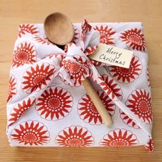 Use a tea towel to wrap up a cookbook for a fresh change to gift wrap. Full photo tutorial