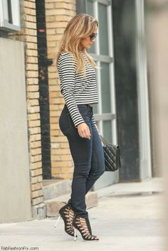 Jennifer Lopez street style with striped crop top and skinny jeans