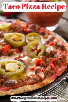 This taco pizza has a homemade base, made from cornmeal, baking powder, flour, butter, milk, and salt. The topping is rich and tasty, featuring delights such as sausage, tomatoes, and cheese. Lettuce, olives, and onions are used to decorate this recipe for homemade taco pizza and the taco seasoning gives it a true Mexican flavor.