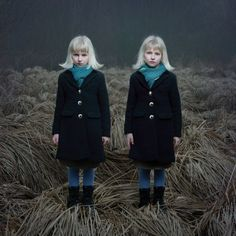 really eerie photos of twins in forests; Tereza Vlčková, 1983, Czech Republic, is a conceptual and fine-art photographer