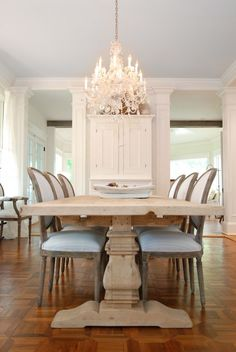wood table and crystal chandelier ... dining room