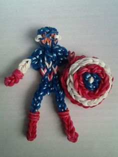 """CAPTAIN AMERICA. Loomed by Tikeesha Buckley on the Rainbow Loom. Tikeesha said: """"...inspired by pg looms [PG Loomacy] action figure 101.....the shield is my design..."""" YouTube tutorial coming."""