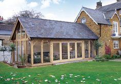 Oak garden room with glazed gable and bi-folding doors