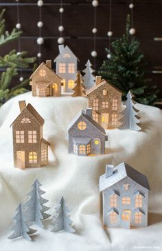 16 Christmas Villages To Celebrate the Season Bring your home to life this holiday season with an adorable DIY Christmas village! Check out these Christmas Town, Christmas Villages, Noel Christmas, Christmas Lights, Christmas Ornaments, Magical Christmas, Christmas Mantles, White Christmas, Diy Christmas Village Houses