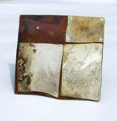 Brooch of copper, repurposed silver plate tray metal, silver, rivets. Fire patina.