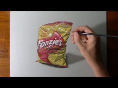 illusion drawing time lapse: How to draw and color a bag of Fonzies chips (Italian version of Twisties), mixed media on gray paper by Marcello Barenghi - . Illusion Drawings, Colored Pencil Tutorial, Chip Bags, Photorealism, Italian Artist, Art Studies, Art Tutorials, Pencil Drawings, Colored Pencils