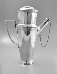 This very stylish Art Deco silver plated cocktail shaker with spout was designed by Keith Murray (1892 - 1981) for Mappin