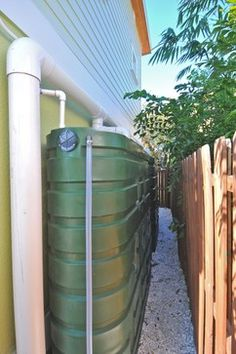 Brilliant water cisterns catch rain water to use for irrigation