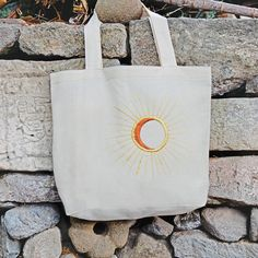 """This tote is sweet and simple, featuring a hand embroidered design on a natural canvas bag. It folds up for easy travel, making it an ideal market bag. H x W x 4 """"D Cotton straps Handmade in a fair trade workshop in Guatemala. Diy Tote Bag, Cute Tote Bags, Embroidery Bags, Embroidery Thread, Simple Bags, Reusable Bags, Canvas Tote Bags, Claddagh, Sterling Silver"""