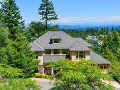GORGOUS CUSTOM BUILT HOME WITH BREATHTAKING MT HOOD VIEWS!! Beauty and comfort combine perfectly in this wonderful space for both family and entertaining. Top line finishes over 6000 Sq Ft of spacious rooms oriented to view. Awesome open-floor plan W/ high ceilings, Tall doors, gourmet kitchen. 2 masters, Brazilian cherry floors, cherry cabinets, ornate millwork. Sauna, Jacuzzi, Tons storage, Media Rm, Workout Rm, Wine cellar, Panic Rm