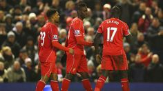 Mario Balotelli (C) of Liverpool celebrates his goal with team mates during the Barclays Premier League match between Liverpool and Tottenham Hotspur at Anfield on February 2015 in Liverpool, England. Liverpool Fc Latest, White Hart Lane, Barclay Premier League, Premier League Matches, Sports Betting, Tottenham Hotspur, Horse Racing, Poker, Mario