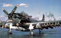 A fully armed A-1H Skyraider at rest at an airfield in Vietnam