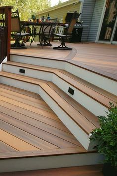 Multi tier trex deck with azek fascia and step lights. Screwless decking except stairs and edge boar Deck Steps, Outdoor Steps, Deck Trim Ideas, Railing Ideas, Deck Edging Ideas, Pergola Ideas, Landscaping Ideas, Deck Step Lights, Outdoor Step Lights