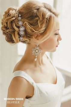 braided bridal updo hairstyle with diamon headpiece