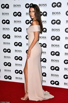 Simply stylish: The creation featured a racy thigh-high split which flaunted her endless legs, lengthened further with a pair of nude satin barely there heels