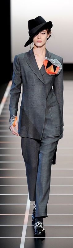 6.Armani Prive F/W 2012-13. Whole outfit wad inspired by men's past-war double breasted, wide-shouldered suit with fedora.
