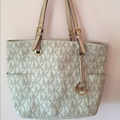 AUTHENTIC Michael Kors Jet Set Signature Tote Light color is perfect for the spring & summer! Used, but in good condition. Some wear on the handles. 3 compartments with 2 zipper pockets - one in the middle of the bag and the other on the back pocket. 2 pockets in both the front and back compartments. MICHAEL Michael Kors Bags Totes