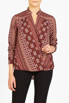 Our soft and voluminous surplice blouse is finished with a flattering blouson front and shirttail hem at the back.