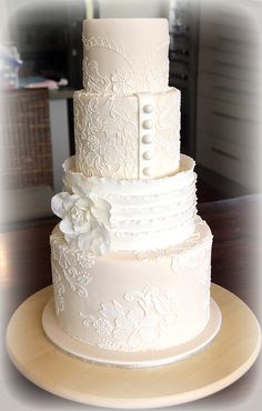 Champagne and Lace Wedding Cake. How to achieve a stunning lace effect on a wedding cake using stencils and piping tutorial.