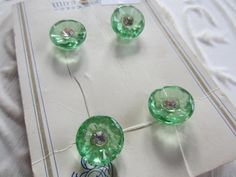 Vintage Buttons - 1 card green glass matching 1940's, rhinestone centers,org. card,(mar257) by pillowtalkswf on Etsy