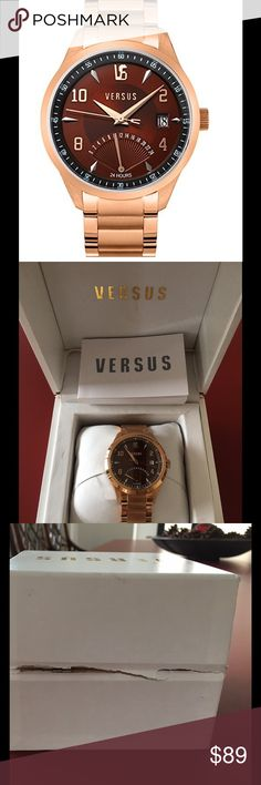 Versus Men's Dial Rose Gold Stainless Steel WATCH This is a New With Tag Versus Men's Brown Dial Rose Gold Stainless Steel Watch. Beautiful. Never worn. Bought for my husband a while ago. The box 📦 is damaged -see picture. May need new Battery since it has never been used. Not sure however it may. Brown face of watch   ⌚️ Versus By Versace Accessories Watches