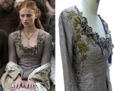 This dress is worn by Sansa during the Tourney of the Hand. Delicate roses adorn the neckline while vines and leaves trail down the sides, leading to embroidered direwolves.