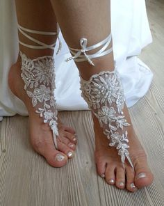 Wedding Fashion Tips from @castlecouturenj – Lace appliqués instead of flip-flops for beach brides! A lot of brides are ordering extra appliqués to wear on their feet. Instead of going barefoot on the beach, trendy brides are dressing up their feet!