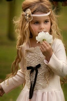 Pretty little girl with long hair & a cute headband!