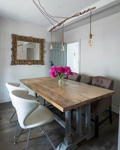 Beautiful fixtures don't always have to be the most expensive; this make-shift chandelier was created using light fittings found in a charity shop and a branch from the back garden! Take a trip to your around your local area to find your next DIY project!  . Photo: Jeremy Phillips . #homebuilding #cottage #renovation #remodel #diningroom #dining #lighting #industrial #cottagestyle #modernrustic #natural #scandi #spring #easter #longweekend #diy #charityshop #homemade #homestyle #modernliving #my