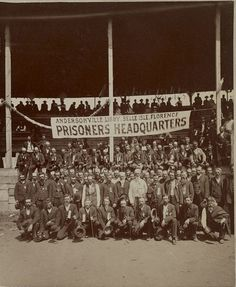 "This portrait shows a group of veteran Union soldiers who were POWs during the Civil War. The banner lists the various Confederate prisons: Andersonville, Libby, Belle Isle and Florence. This photo was taken at a POW reunion, possibly the 18th National Encampment of the Grand Army of the Republic in Minneapolis in 1884. The original title was ""Great group of ex-Union prisoners"". (History By Zim)"