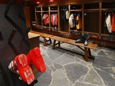 locker room area for guests to hang up coats and shoes and stuff