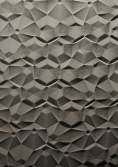 Curve Milling / Part of a series of studies proposing new architectural surfaces. This is a grid of nested hexagons with linework radiating from the center of each module. It was designed, drawn and fabricated digitally. The material is mdf milled with a CNC router.
