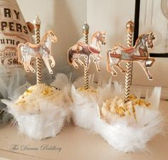 Feathered cupcake holders with carousel horse toppers www.thedreampeddlery.com