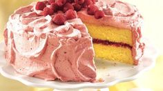 Delight in a delicious cake with raspberry filling and raspberry-whipped cream mousse frosting.