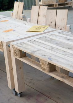Pallet tables on wheels, perfect for the kids to play at and eat on while BBQing...l