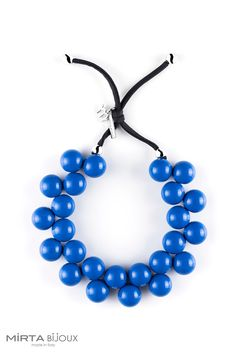Theresa May's Blue Balls necklace by Mirta Bijoux.