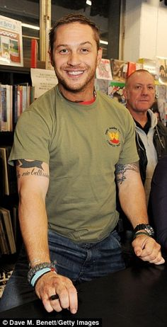Cheeky chappy: Tom Hardy grins at the signing of Blag's 20th anniversary edition