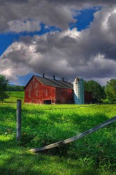 Red barn and a cloudy day.