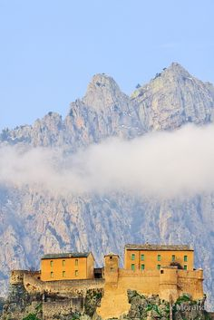 Corte, the citadel, the mountains and the clouds. France, North Corsica.