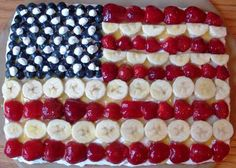 I make this every 4th of July. It's called fruit pizza, but it's easy to make it into a flag! sugar cookie dough rolled out onto cookie sheet for crust. a layer of cream cheese (wait to spread until cookie is cool) then add your flag with fruit! i springkle it lightly with sugar.